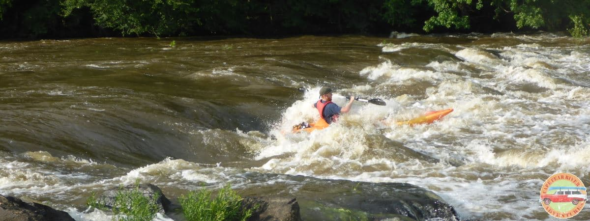 whitewater kayaker in rapid