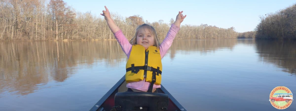 girl in rented canoe from cape fear river adventures located in Lillington, NC