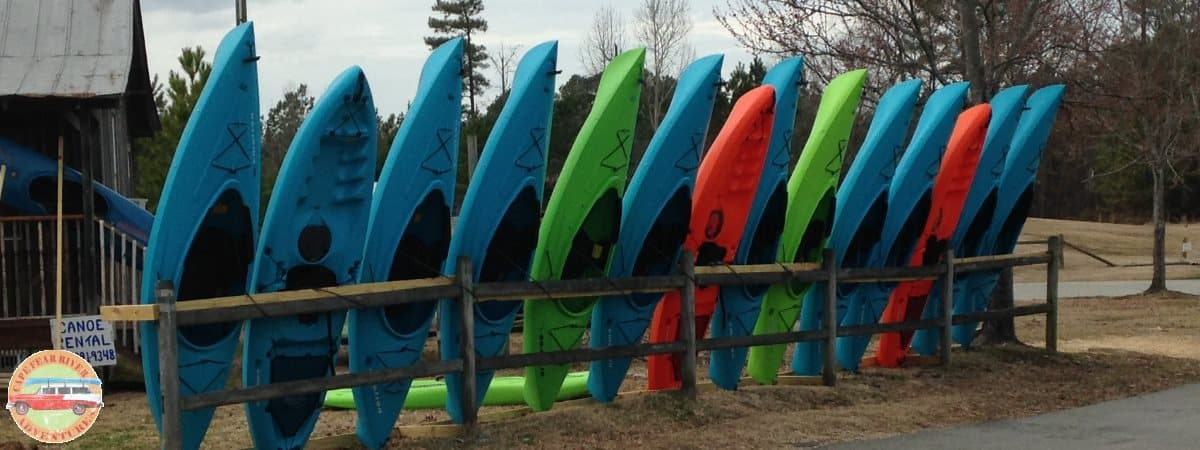 standing kayaks by canoe cabin in Lillington, NC